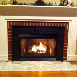 Propane gas fireplace log insert.